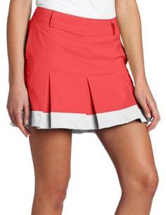 club lady in maroon skirt swinging golfer